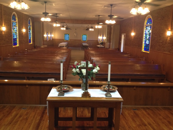 View of the redecorated Pine Ridge UMC from the platform.  New items include: paint, ceiling fans, sconces, carpet, and refinishing wood on the platform.