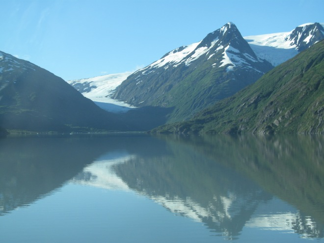 A view of the Portage Glacier with reflection in Portage Lake near Whittier, Alaska.