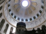 Sunlight streams into the Church of the Holy Sepulcher over the tomb of Jesus.