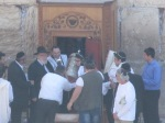 Young man being handed the Torah scroll during his Bar Mitzah ceremony at the Western Wall.